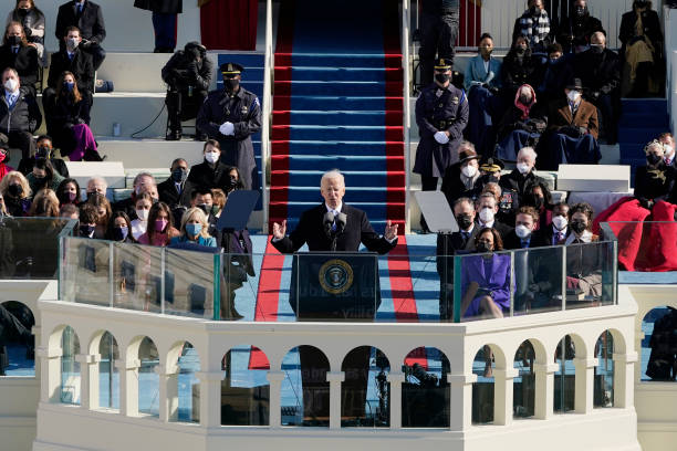 President Joe Biden urges a divided nation to 'end this uncivil war' in inaugural address
