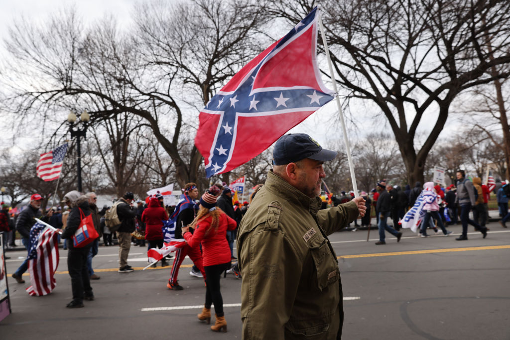 As Trump's mob ransacked the Capitol, a Confederate flag was the least surprising sight